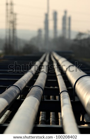 pipe with crude oil going to refinery - stock photo