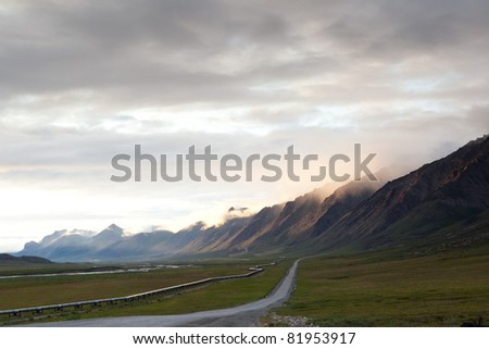 Pipeline along side Dalton highway leading to mountain near Sukakpak Mountain, Alaska - stock photo