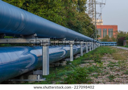 Pipeline next to a street at sunset - stock photo