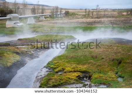 Pipeline, Steaming geothermal hot water, Iceland - stock photo