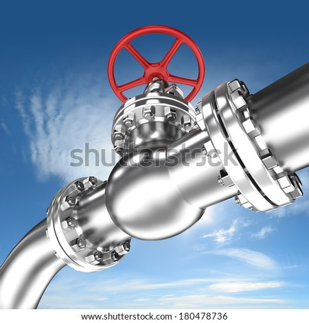 Pipeline with red valve on sky background - stock photo