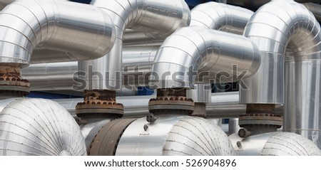 pipelines and destillation tanks of an oil-refinery plant close up