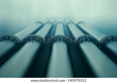 Pipelines disappear in the depths of the ocean.  Pipeline transportation is most common way of transporting goods such as oil, natural gas or water on long distances. - stock photo