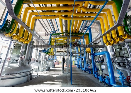 Pipelines of an oil refinery from the inside.  - stock photo