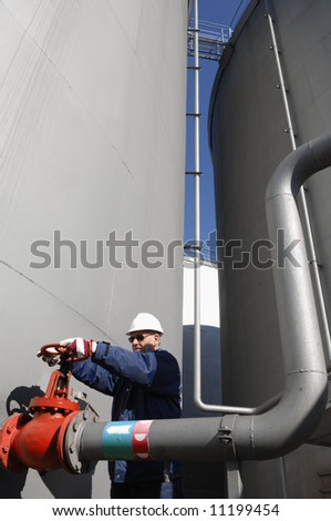 pipelines, pumps, fuel-tanks and engineer - stock photo