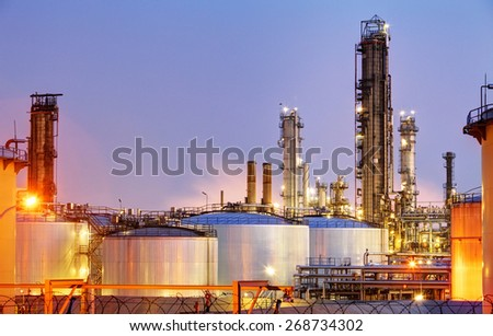 Pipes and tanks of oil refinery - factory - stock photo