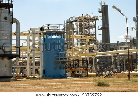 Pipes and technological structure of the gas processing plant. - stock photo