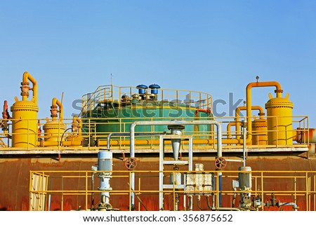 Pipes and valves of oil field, oil industry equipment