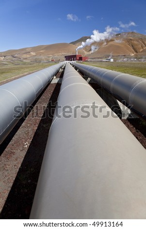 Pipes leading to a geothermal power station in Iceland in the Krafla Volcanic region of Iceland. - stock photo