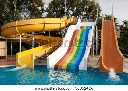 Pipes of a hill in an aquapark near the pool - stock photo