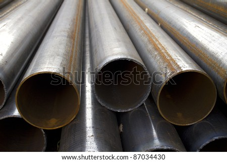 Pipes  stack  round  cut  steel - stock photo