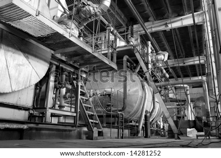 Pipes, tubes, machinery and steam turbine at a power plant    black and white