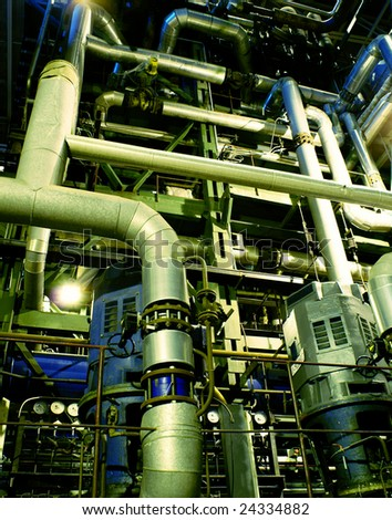 Pipes, tubes, pumps and steam turbine at a power plant - stock photo