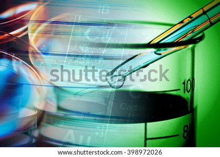 Pipette and laboratory glass. Science concept. - stock photo