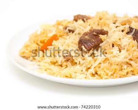 Piping hot pilau on a plate - stock photo