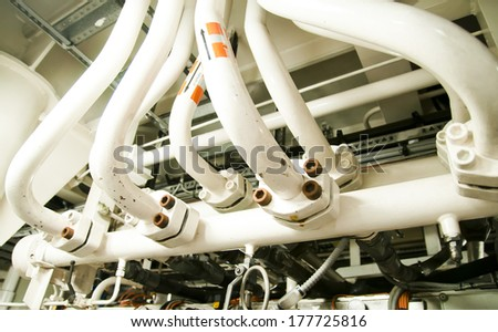 Piping in Engine Room Spaces on a modern vessel - engineering interior - stock photo