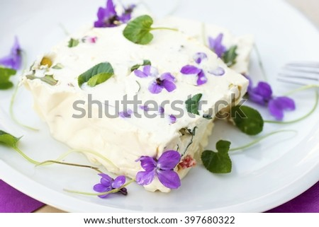 Piquant whipped gelatin cream with vegetable and egg and edible blooming flower, (nice spring and easter traditional food in Czech republic) - stock photo