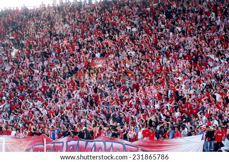 Piraeus, Greece,April 27,2005. Fans of Olympiacos ,the most popular Greek club with around two and a half million fans inside Greece and millions of others in the Greek communities all over the world. - stock photo