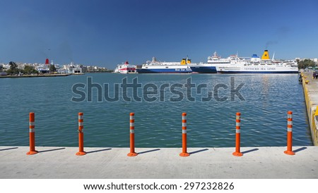 PIRAEUS, GREECE - MAY 04: Commercial Port in Piraeus on MAY 04, 2015. Docks with Ships and Ferryboats in Biggest Greek Seaport in Piraeus, Greece. - stock photo
