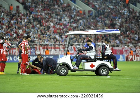 Piraeus, Greece Oct. 22, 2014. Electric ambulance with first aids in the field of Georgios.Karaiskakis stadium in piraeus, for Olympiacos's Giannis Maniatis ,during the game Olympiacos vs Juventus. - stock photo