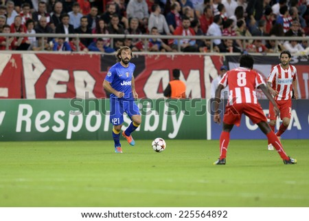 Piraeus, Greece Oct. 22, 2014.Juventus Andrea Pirlo with the ball, during t the Champions League football match between Olympiakos vs Juventus (1-0) at Karaiskaki Stadium in Piraeus - stock photo