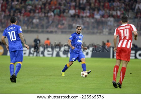 Piraeus, Greece Oct. 22, 2014.Juventus Giorgio Shiellini, with the ball, during t the Champions League football match between Olympiakos vs Juventus (1-0) at Karaiskaki Stadium in Piraeus - stock photo