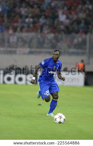 Piraeus, Greece Oct. 22, 2014.Juventus Kwadwo Asamoah, with the ball, during t the Champions League football match between Olympiakos vs Juventus (1-0) at Karaiskaki Stadium in Piraeus - stock photo