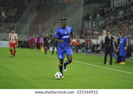 Piraeus, Greece Oct. 22, 2014.Juventus Paul Pogba, with the ball, during t the Champions League football match between Olympiakos vs Juventus (1-0) at Karaiskaki Stadium in Piraeus - stock photo