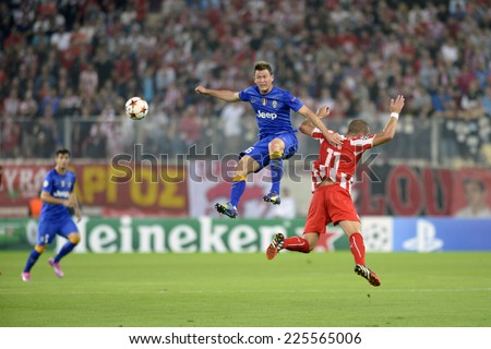Piraeus, Greece Oct. 22, 2014.Juventus Stephan Lichtsteiner  during t the Champions League football match between Olympiakos vs Juventus (1-0) at Karaiskaki Stadium in Piraeus - stock photo