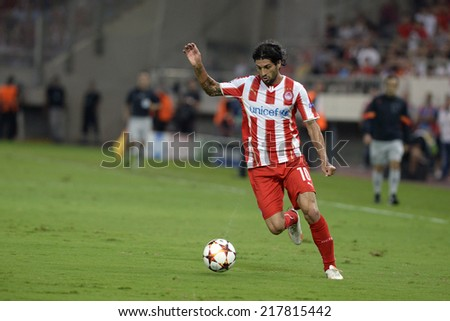 Piraeus,Greece Sept 16, 2014. Olympiacos Alejandro Dominguesl during the Champions League soccer match between Olympiakos and Atletico Madrid at G.Karaiskakis Stadium in Piraeus. - stock photo