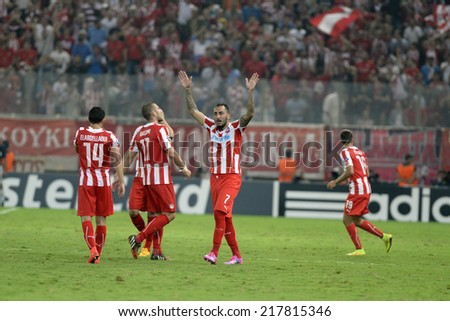 Piraeus,Greece Sept 16, 2014.  Olympiacos  Kostas Mitroglou center celebrates his goal with teammates during a Champions soccer match between Olympiakos and Atletico Madrid at Karaiskakis Stadium. - stock photo