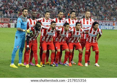 Piraeus,Greece Sept 16, 2014. Olympiacos team pose for the photographers before the Champions League soccer match against Atletico at Georgios Karaiskakis Stadium in the port of Piraeus near Athens - stock photo