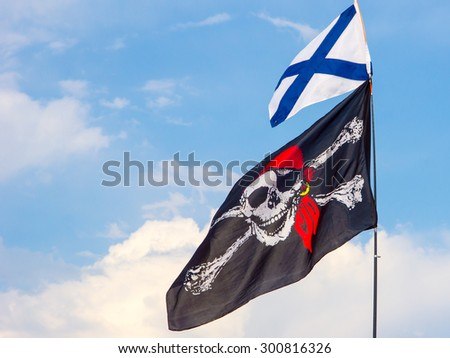 Pirate and St. Andrew's flags - stock photo