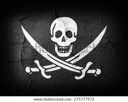 Pirate  flag and wall background - stock photo