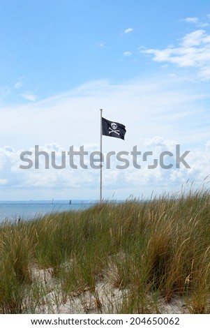 pirate flag at a baltic sea beach  - stock photo