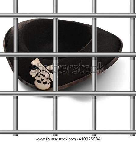 Pirate hat against the backdrop of prison bars.International terrorism.Law and Freedom.Prison. - stock photo