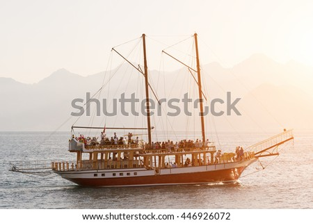 Pirate ship with a group of tourists - stock photo