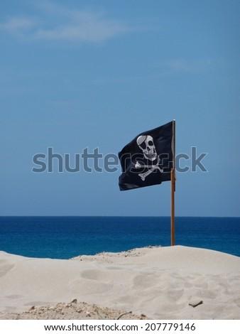 pirates flag on a beach - stock photo