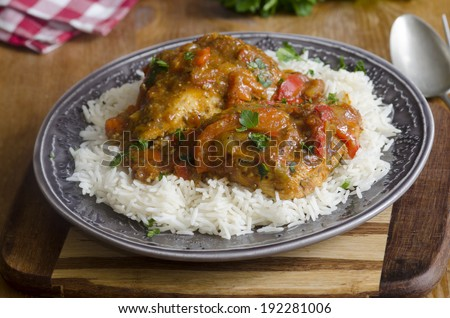 Piri piri chicken with chopped jalape�±os and roasted peppers - stock photo