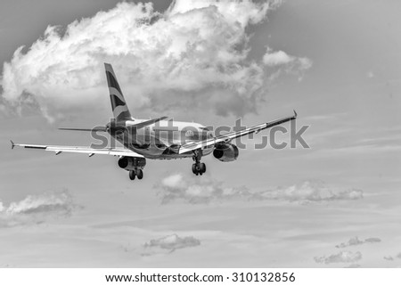 PISA, ITALY - AUG 25, 2015: British Airways airplane lands in Pisa airport on August 25, 2015. British Airways is one of the oldest airlines and rated top 3 biggest in Europe. - stock photo