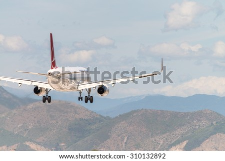PISA, ITALY - AUG 25: Turkish Airlines plane lands in Pisa airport, August 25, 2015. Turkish Airlines is one of the best companies in Europe. - stock photo
