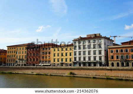 PISA, ITALY - AUGUST 21, 2014: Row of buildings by the Arno river