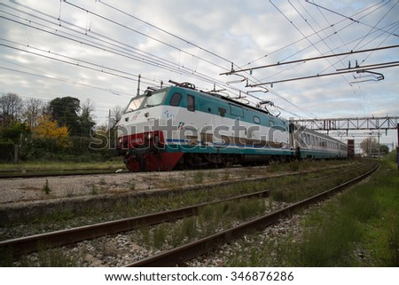 PISA - ITALY: DECEMBER, 3 2015: Intercity Trenitalia Passenger Train with Electric E444 Locomotive is Passing in a Station