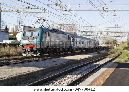 PISA - ITALY: DECEMBER, 10 2015: Trenitalia Passenger Train with Electrical Locomotive E464 is arriving in a Station