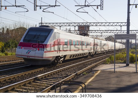 PISA - ITALY: DECEMBER, 10 2015: Trenitalia Red Electrical Train Frecciabianca model etr 460 is Passing from a Station of Pisa San Rossore