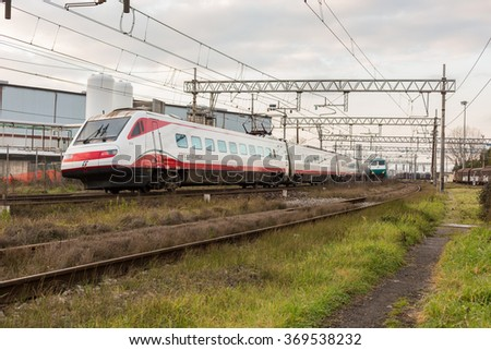 PISA-ITALY: JANUARY, 28 2016: Trenitalia Frecciabianca Passenger High Speed Train Model etr 460 is Passing from the Station