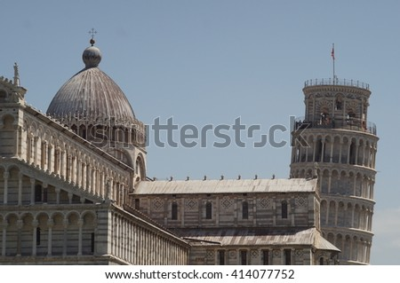 Pisa - Italy - July 28, 2015: The leaning Tower of Pisa behind the cathedral