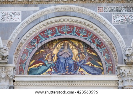 PISA, ITALY - JUNE 06, 2015: A colourful mosaic by Giuseppe Modena da Lucca, of the Virgin Mary, above the middle door of Cathedral in Pisa, Italy. Unesco World Heritage Site, on June 06, 2015 - stock photo