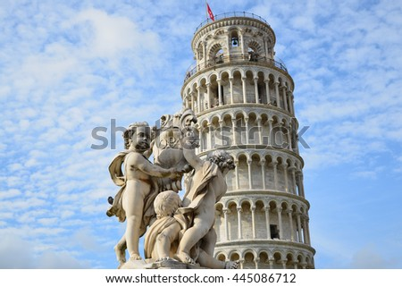 Pisa Italy, marble angels and leaning tower - stock photo