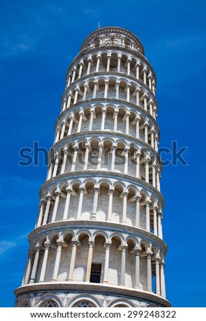 PISA, ITALY - MAY 10, 2014: Tourists on Leaning Tower in Pisa, Italy. Leaning Tower of Pisa is campanile and is one of the most famous buildings in the world - stock photo